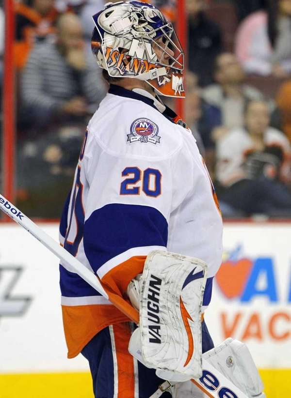 New York Islanders goalie Evgeni Nabokov pauses during