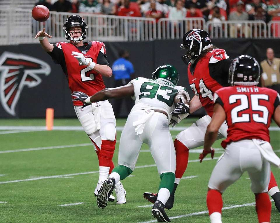 Atlanta Falcons quarterback Matt Ryan dumps off a