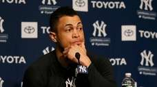 Giancarlo Stanton speaks to reporters before the Yankees'