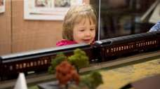 Izzy Hamilton, 3, watches as a model train