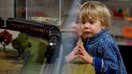 Jamie Hamilton, 4, watches as a model train