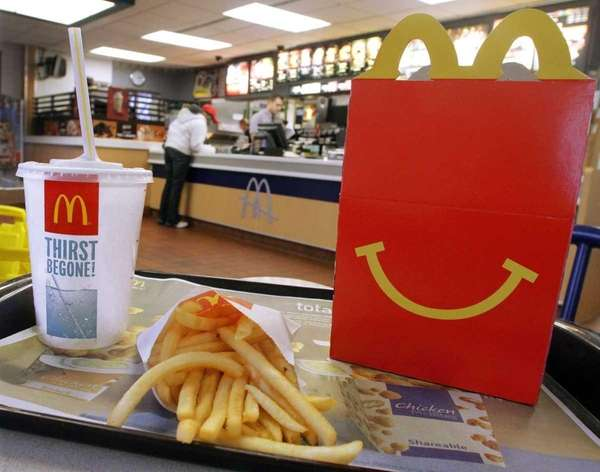 The McDonald's logo and a Happy Meal box