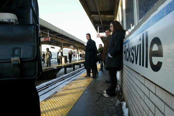 People wait for trains at the Hicksville LIRR