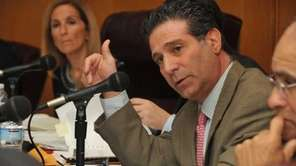 Democratic councilman Michael Fagen responds to a presentation