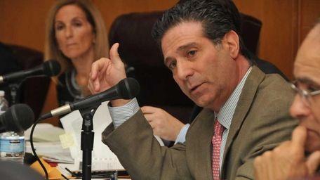 Democratic councilman Michael Fagen responds to a presentation