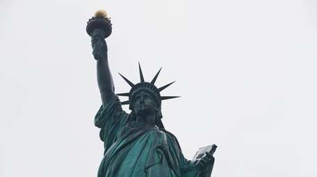 The Statue of Liberty wields her torch on