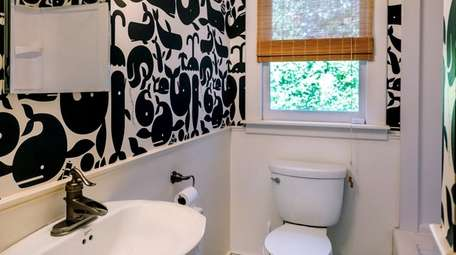 The bathroom in a Bellport home listed for