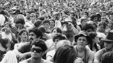 Concert goers attend the Woodstock Music and Arts