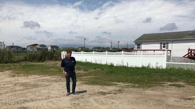 Lindenhurst Mayor Michael Lavorata stands on one of