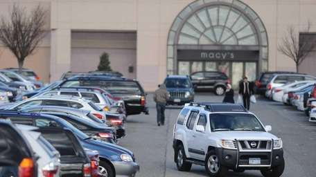 Jammed parking lot and last minute shoppers at