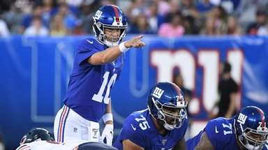 Giants quarterback Eli Manning gestures during the first