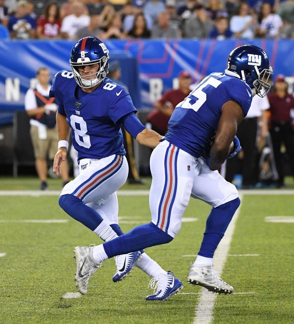 New York Giants quarterback Daniel Jones hands the