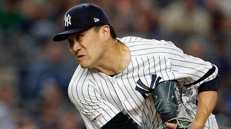 Masahiro Tanaka #19 of the Yankees pitches during