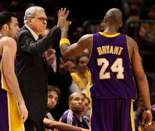 Los Angeles Lakers coach Phil Jackson congratulates guard