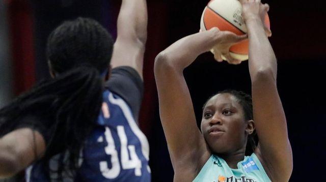 Liberty center Tina Charles shoots as Minnesota Lynx