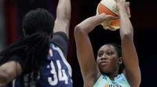 Liberty center Tina Charles shoots as Minnesota Lynx