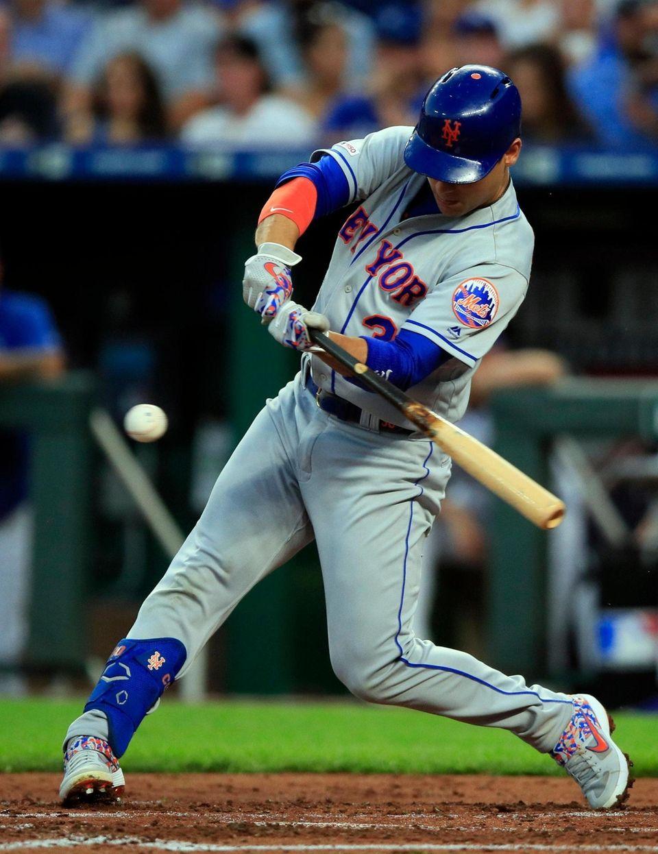 New York Mets' Michael Conforto hits an RBI-single