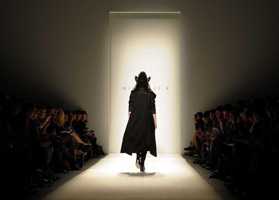 A model displays the fashion of Nicholas K