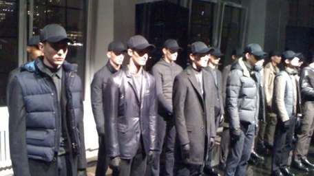 Models stand like sentries at the DKNY Men