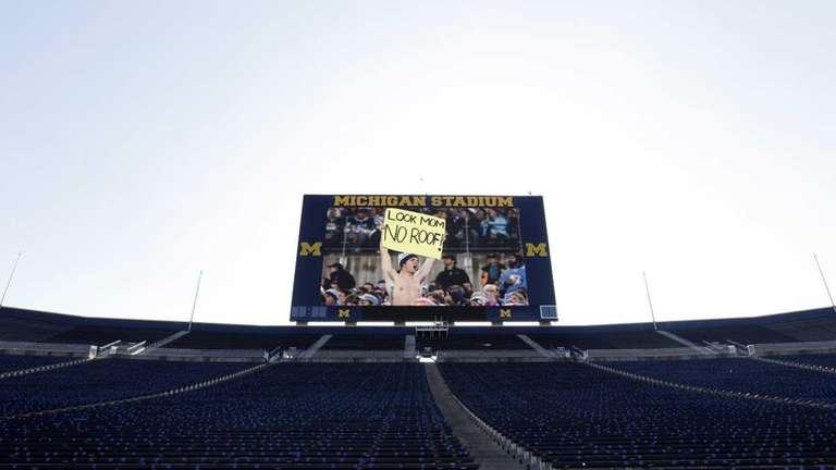 The scoreboard at Michigan Stadium plays a video