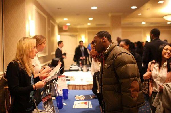 Job seekers attend a career fair in midtown