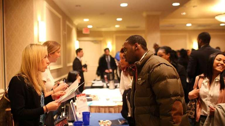 Job seekers attend a career fair in midtown