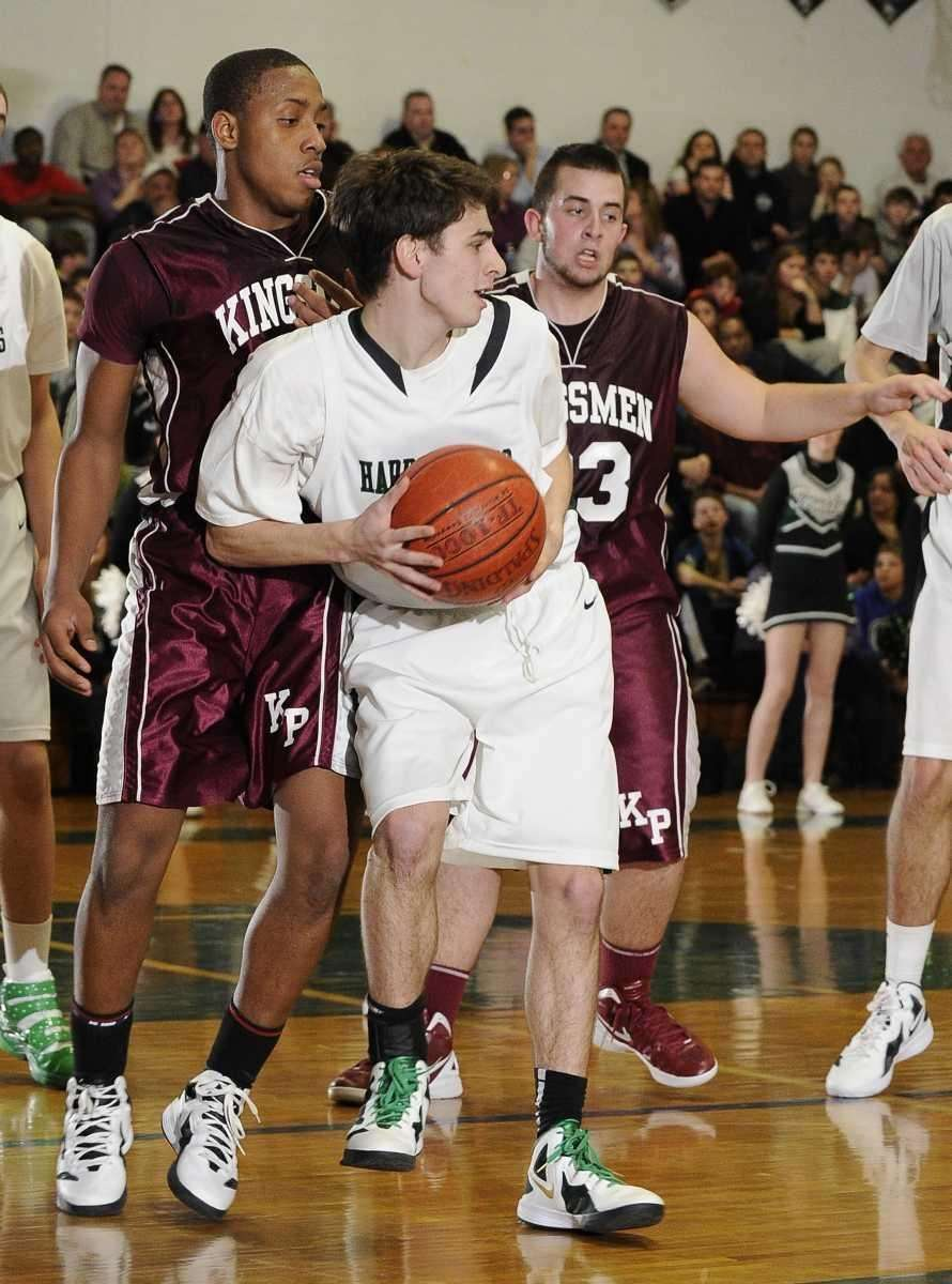 Harborfields' Ryan Logrieco protects the ball from Kings