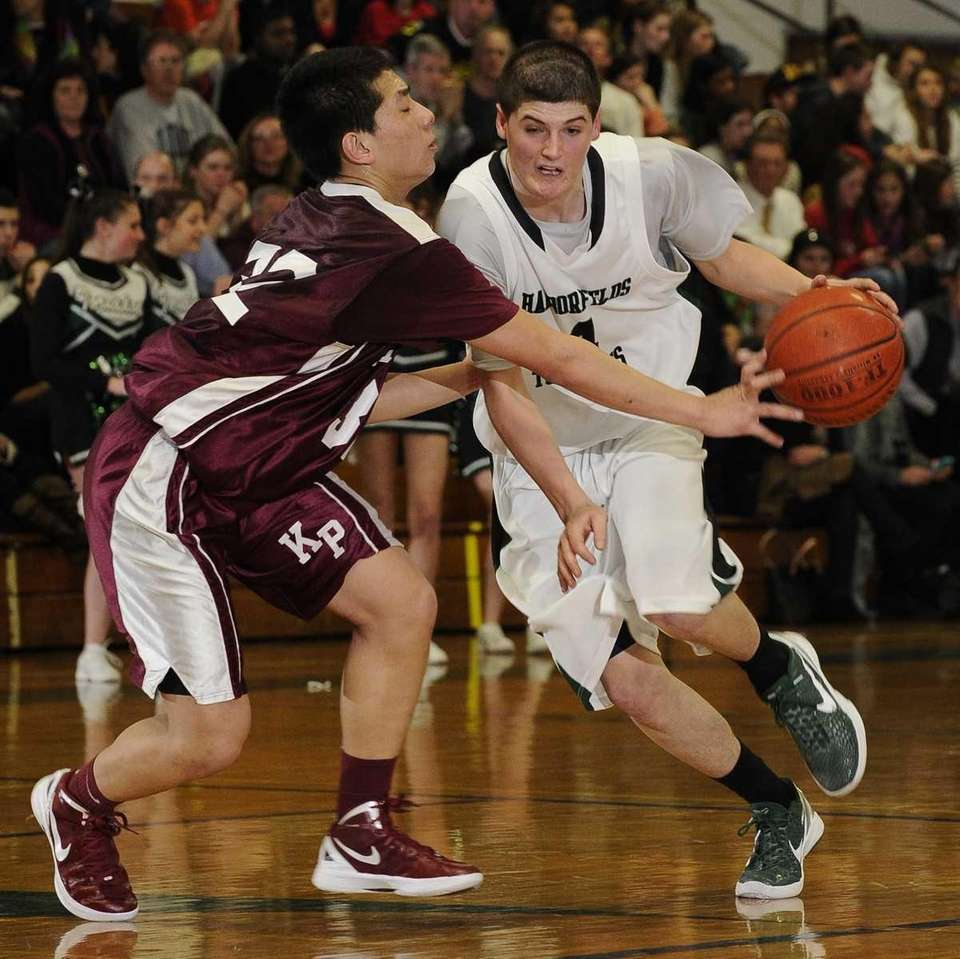 Harborfields' Justin Ringen drives around Kings Park's John