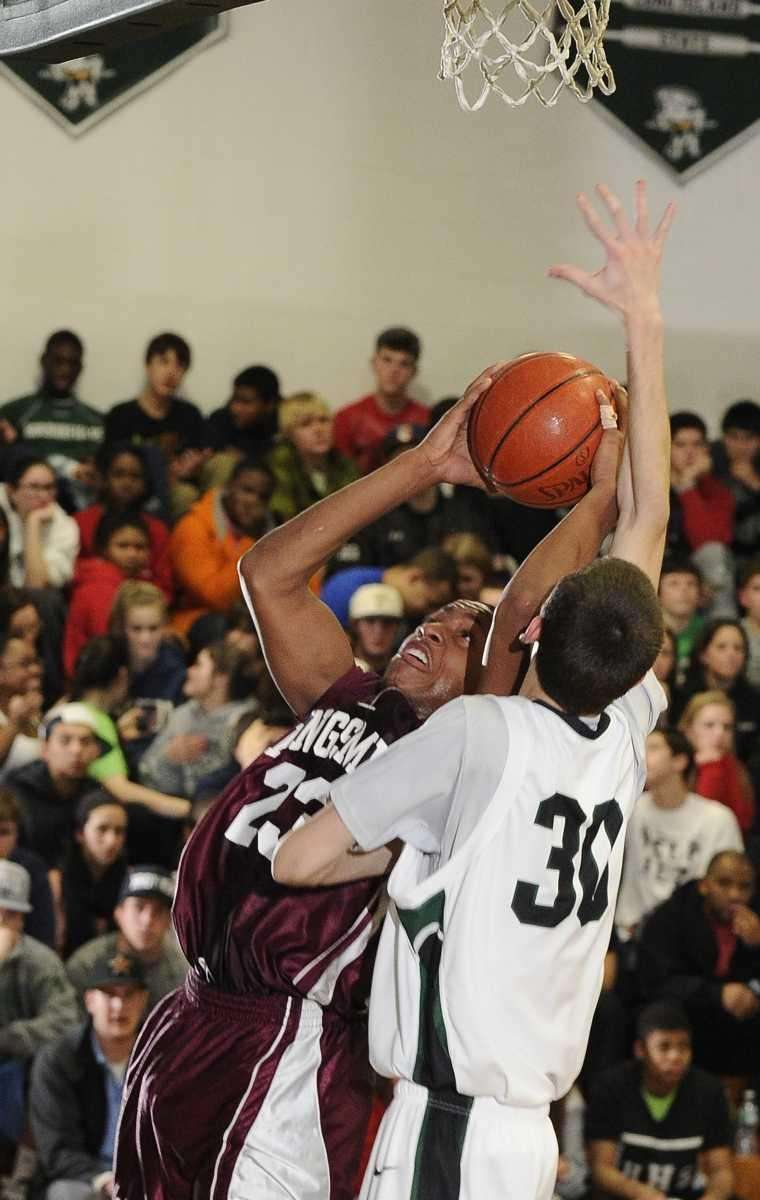 Harborfields' Jimmy Smith guards Kings Park's Craig Jeudy