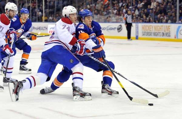 Aleei Emelin of the Canadiens pushes P.A. Parenteau