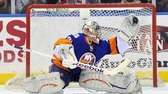 Islanders goalie Evgeni Nabokov makes a glove save.