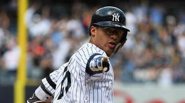 New York Yankees shortstop Gleyber Torres reacts to