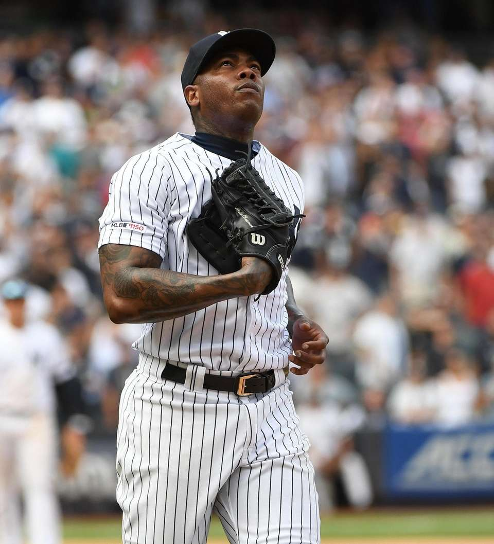 New York Yankees relief pitcher Aroldis Chapman watches