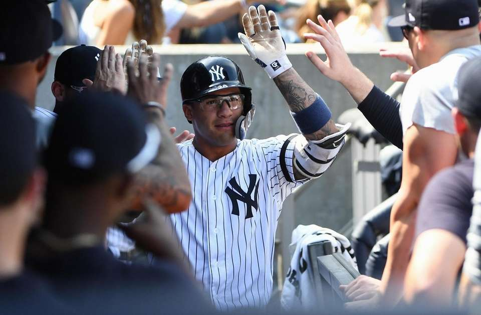 New York Yankees shortstop Gleyber Torres is greeted