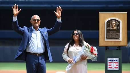 Yankees pitching great Mariano Rivera gestures to fans