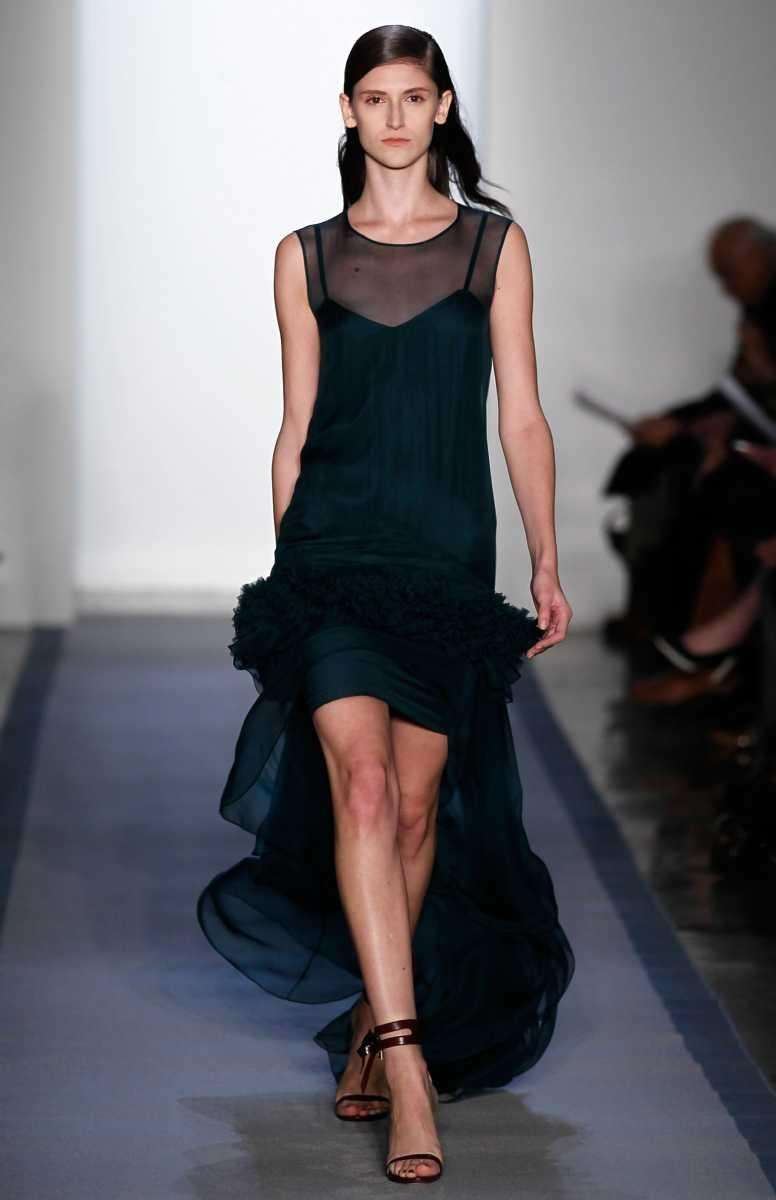 A model walks the runway at the Peter