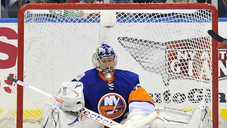 Islanders goalie Evgeni Nabokov closes his eyes as