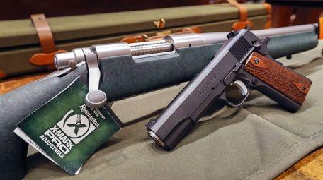 A Remington rifle and handgun on display at