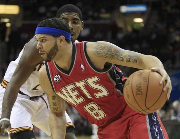 New Jersey Nets point guard Deron Williams drives