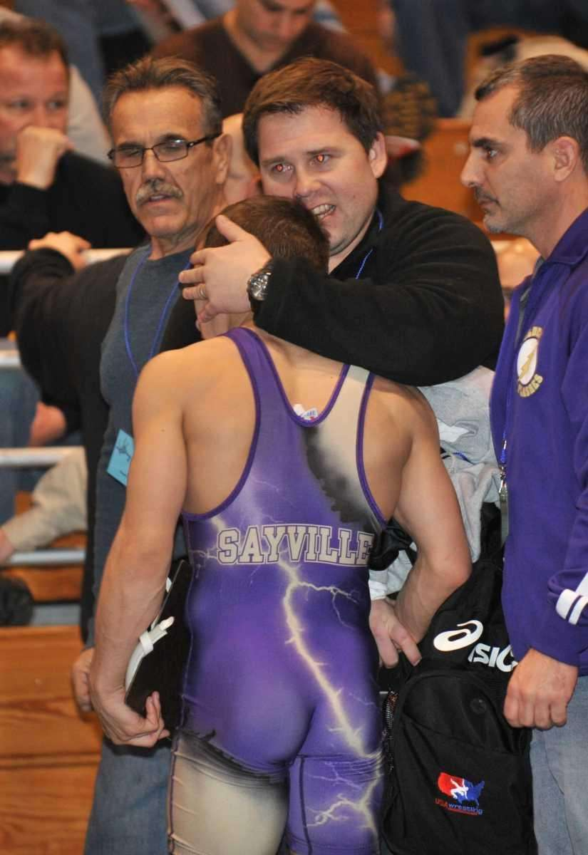 Islip's Natt Haag (purple) is congratulated after beating