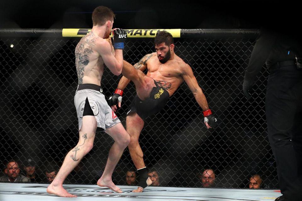 Raphael Assuncao sends a kick to Cory Sandhagen