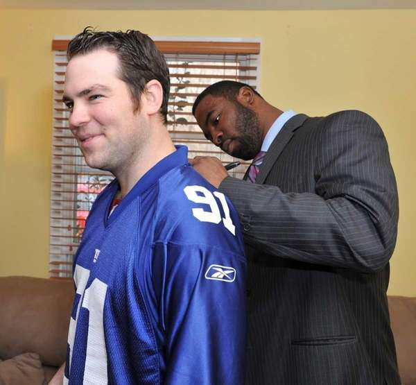 NYPD officer Kevin Brennan gets his Giants jeresey