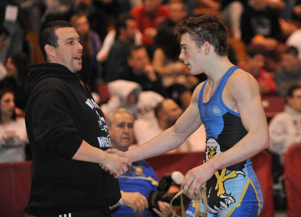 Nick Mauriello of Haupauge, right, is congratulated after