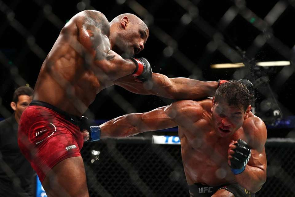 Paulo Costa throws a punch at Yoel Romero