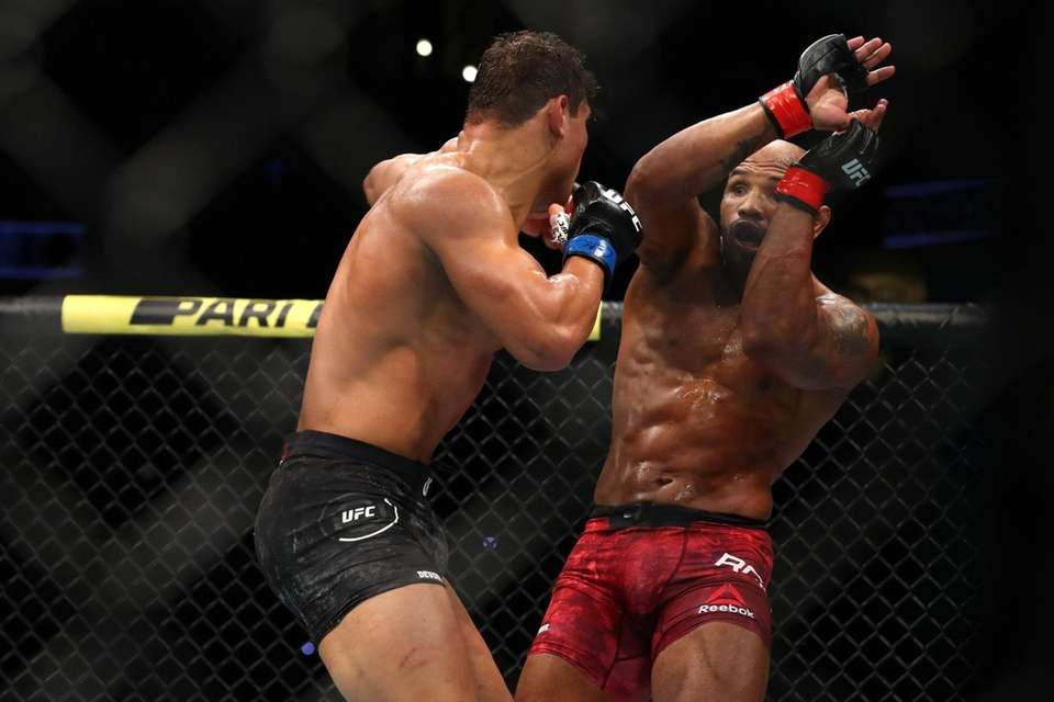 Paulo Costa throws a punch in the second