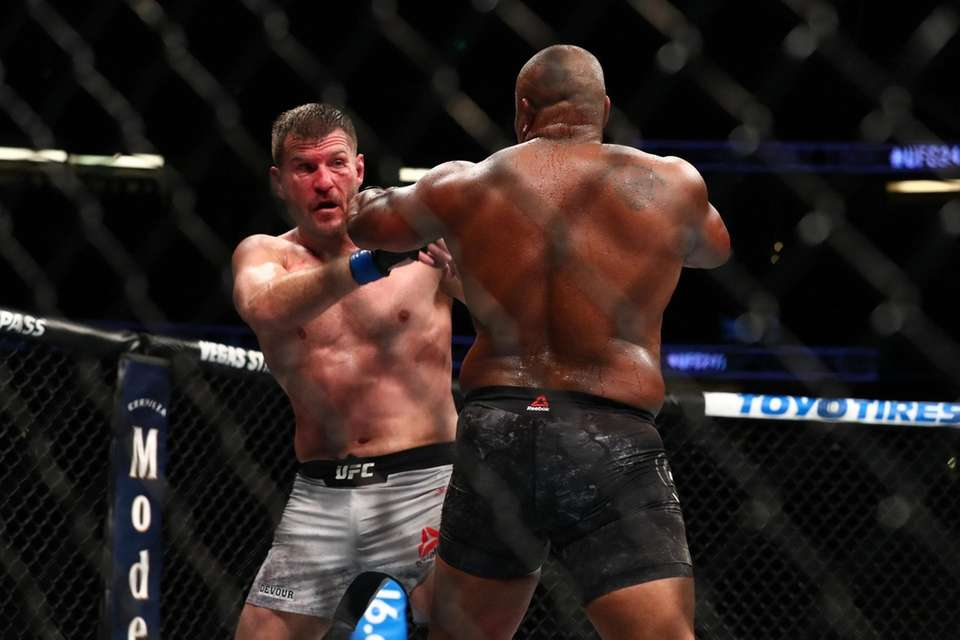 Stipe Miocic and Daniel Cormier in action in