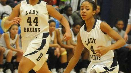 Baldwin senior Alex Hampton, right, and teammate Janae