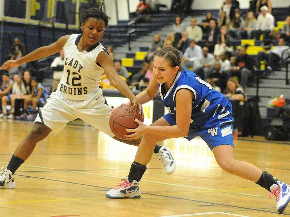 Baldwin senior Ashley Sobel, left, guards Port Washington's