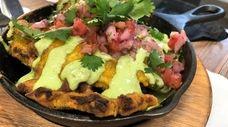 A creative twist on nachos featuring plantain chips,