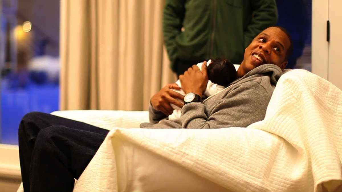 Rapper Jay Z holds his daughter, Blue Ivy,